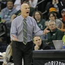 Green Bay's head coach Kevin Borseth reacts to a jump ball call made by officials during the first half of the Horizon League Women's Basketball Championship game against Loyola, Sunday March 17, 2013, at the Kress Events Center in Green Bay, Wis. (AP Photo/Matt Ludtke)