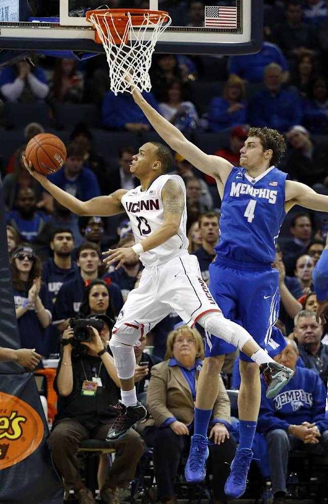Connecticut guard Shabazz Napier (13) drives past Memphis forward Austin Nichols (4) to score during the second half of an NCAA college basketball game in the quarterfinals of the American Athletic Conference men's tournament Thursday, March 13, 2014, in Memphis, Tenn