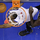Philadelphia 76ers' Thaddeus Young, left, watches his shot as Orlando Magic's Andrew Nicholson defends during the second half of an NBA basketball game, Tuesday, Dec. 3, 2013, in Philadelphia The Associated Press