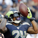 Seattle Seahawks' Marshawn Lynch reacts after rushing for a first down against the Denver Broncos in overtime of an NFL football game, Sunday, Sept. 21, 2014, in Seattle. The Seahawks won 26-20 The Associated Press