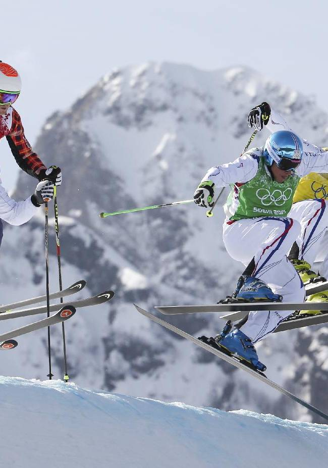 Jean Frederic Chapuis, front right, Arnaud Bovolenta, front left, Jonathan Midol, all of France, background right, and Brady Leman of Canada, background left, compete in the men's ski cross final at the Rosa Khutor Extreme Park, at the 2014 Winter Olympics, Thursday, Feb. 20, 2014, in Krasnaya Polyana, Russia. Chapuis won ahead of Bovolenta and Midol