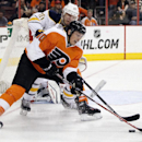 Philadelphia Flyers' Vincent Lecavalier, front, vies for controls of the puck with Buffalo Sabres' Christian Ehrhoff during the second period of an NHL hockey game, Sunday, April 6, 2014, in Philadelphia. The Flyers won 5-2 The Associated Press