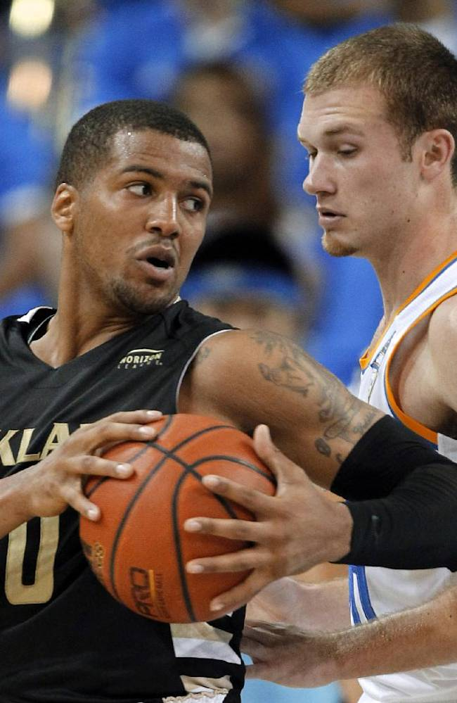 FILE- In a Nov. 12, 2013 file photo, Oakland guard Duke Mondy, left, takes the ball around UCLA guard Bryce Alford during the second half of an NCAA college basketball game in Los Angeles. Mondy is among the nation's leaders in steals, reviving a college career that once seemed headed off the rails