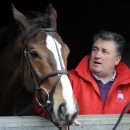 FILE - In this Wednesday, Feb. 24, 2010 file photo, racehorse trainer Paul Nicholls stands next to Cheltenham Gold Cup hope, Kauto Star at Manor Farm Stables in Ditcheat, western England. Kauto Star, one of Britain's greatest and most popular racehorses, has been euthanized after sustaining pelvis and neck injuries in a fall in a paddock. Laura Collett, who rode Kauto Star in dressage following his retirement from jump racing in 2012, said in a Twitter post that