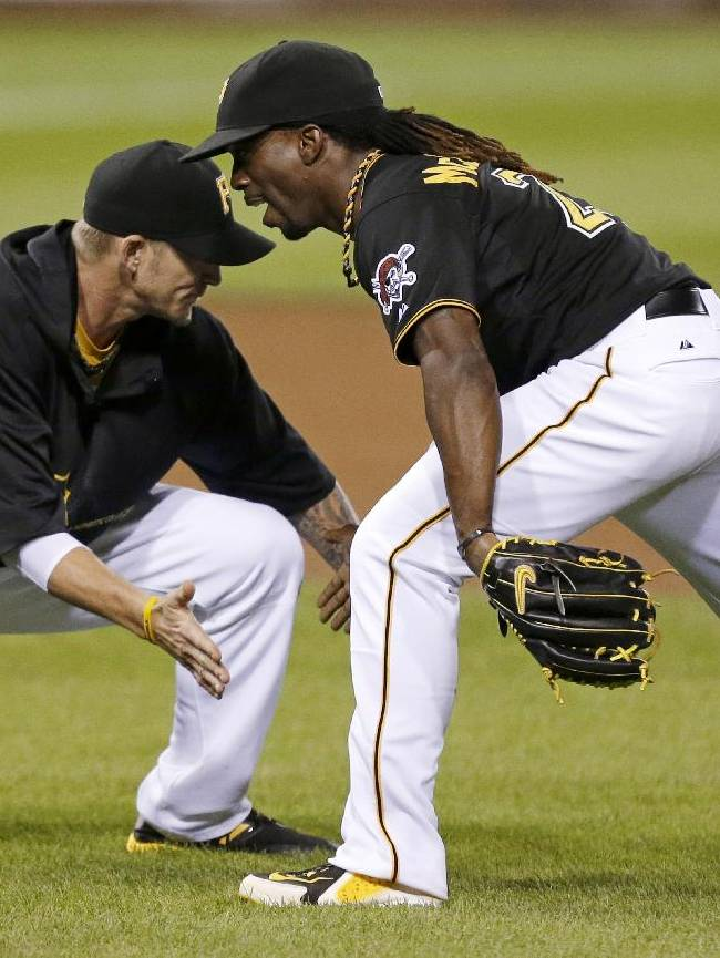 In this July 31, 2013, file photo, Pittsburgh Pirates center fielder Andrew McCutchen , right, celebrates with  A.J. Burnett after the Pirates' 5-4 win over the St. Louis Cardinals in a baseball game in Pittsburgh. McCutchen might be the best player on the Pirates, but he's not their chief recruiter. The All-Star center fielder doesn't plan to make any calls to right-hander Burnett, right fielder Marlon Byrd or any of Pittsburgh's other free agents in an attempt to talk them into staying