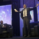 NCAA President Mark Emmert, right, tells a humorous story about the size of former NBA great Shaquille ONeal, left, at the NCAA's convention keynote luncheon Wednesday, Jan. 16, 2013, in Grapevine, Texas. O'Neal spoke about the importance of education in his life and the value his three degrees bring in his post-NBA basketball career. (AP Photo/LM Otero)