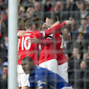 Manchester United's Radamel Falcao Garcia, center, celebrates with teammates after scoring against Leicester during the English Premier League soccer match between Manchester United and Leicester at Old Trafford Stadium, Manchester, England, Saturdaym Jan
