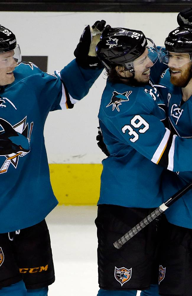 San Jose Sharks' Martin Havlat, right, of the Czech Republic, celebrates his third goal of the game against the Colorado Avalanche with teammates Logan Couture (39) and Matt Irwin (52) during the third period of an NHL hockey game on Friday, April 11, 2014, in San Jose, Calif. San Jose won 5-1