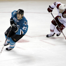 San Jose Sharks' Scott Hannan, left, is chased by Arizona Coyotes' Tobias Rieder (8) during the second period of an NHL preseason hockey game Friday, Sept. 26, 2014, in San Jose, Calif. The Associated Press