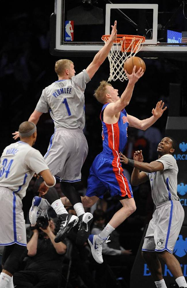 Brooklyn Nets' Paul Pierce (34), Mason Plumlee (1) and Joe Johnson (7) block the shot of Detroit Pistons' Kyle Singler in the first half of an NBA basketball game on Friday, April 4, 2014, in New York
