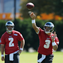Philadelphia Eagles quarterback Mark Sanchez (3) throws a pass as quarterback Matt Barkley looks on during NFL football practice at the team's training facility, Tuesday, Sept. 23, 2014, in Philadelphia. The Associated Press