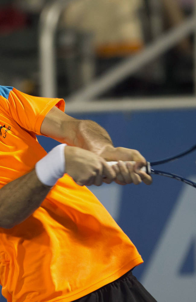Marin Cilic, of Croatia, returns the ball to Kevin Anderson during the Delray Beach Open tennis tournament, Sunday, Feb. 23, 2014, in Delray Beach, Fla. Cilic won 7-6 (6), 6-7 (7), 6-4