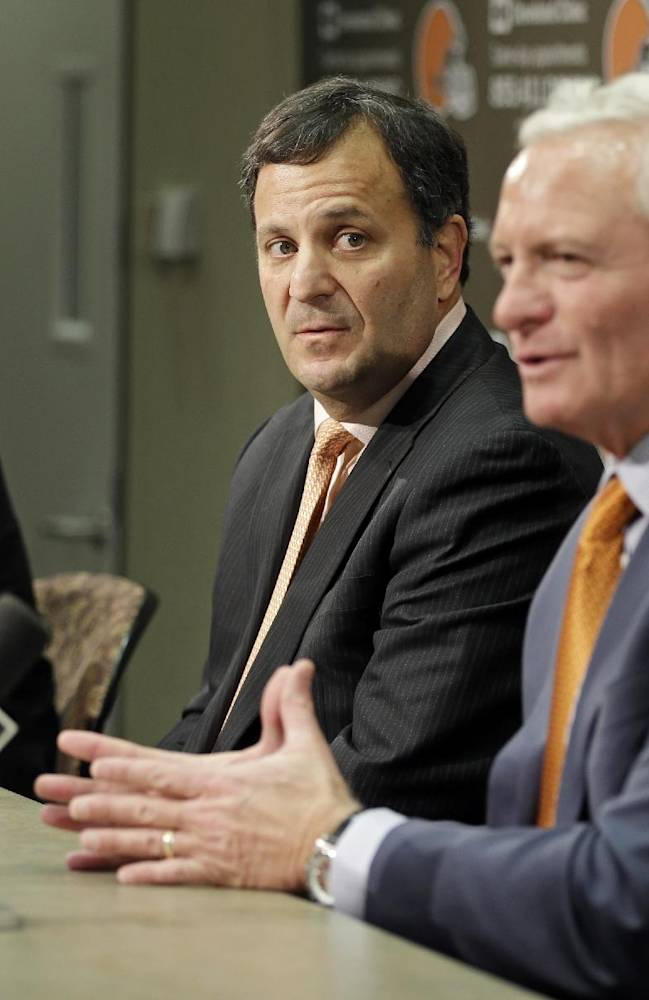 Mike Lombardi, center, the Cleveland Browns' vice president of player personnel, listens as owner Jimmy Haslam, right, speaks during a press conference at the NFL football team's practice facility in Berea, Ohio, Friday, Jan. 18, 2013. Browns' CEO Joe Bannler looks on, left