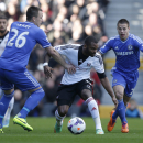 Fulham's Darren Bent, center, competes with Chelsea's John Terry, left, and Cesar Azpilicueta during their English Premier League soccer match at Craven Cottage, London, Saturday, March 1, 2014