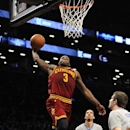 Cleveland Cavaliers' Dion Waiters (3) goes to the basket over Brooklyn Nets' Shaun Livingston (14) and Mirza Teletovic (33) during the second half of an NBA basketball game Friday, March 28, 2014, in New York. The Nets won 108-97 The Associated Press