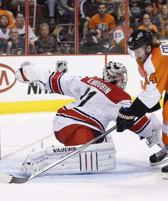 Philadelphia Flyers' Sean Couturier, right, makes his move on Carolina Hurricanes' Anton Khudobin, left, of Russia, for a goal during the second period of an NHL hockey game, Sunday, April 13, 2014, in Philadelphia