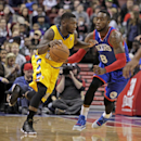 Denver Nuggets' Nate Robinson, left, drives against Philadelphia 76ers' Tony Wroten (8) in the first half of an NBA basketball game Saturday Dec. 7, 2013, in Philadelphia The Associated Press