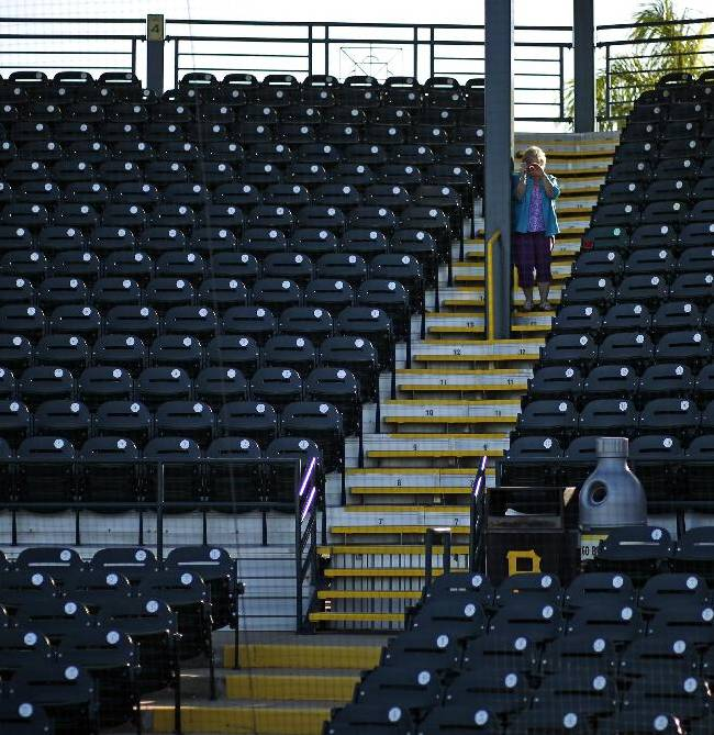 Jackie Moravick of Conneaut Lake, Pa., takes pictures from the stands at the spring training home of the Pittsburgh Pirates, McKechnie Field, in Bradenton, Fla., Monday, Feb. 10, 2014. Pirates pitchers and catchers begin workouts on Thursday, Feb. 13