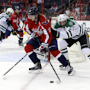 Washington Capitals center Nicklas Backstrom (19), from Sweden, skates with the puck with Dallas Stars defenseman Sergei Gonchar (55), from Russia, in the first period of an NHL hockey game, Tuesday, April 1, 2014, in Washington The Associated Press