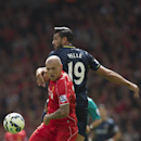Liverpool's Martin Skrtel, left, fights for the ball against Southampton's Graziano Pelle during their English Premier League soccer match at Anfield Stadium, Liverpool, England, Sunday Aug. 17, 2014