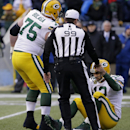 Green Bay Packers' Aaron Rodgers is helped up after being sacked during the second half of the NFL football NFC Championship game against the Seattle Seahawks Sunday, Jan. 18, 2015, in Seattle The Associated Press