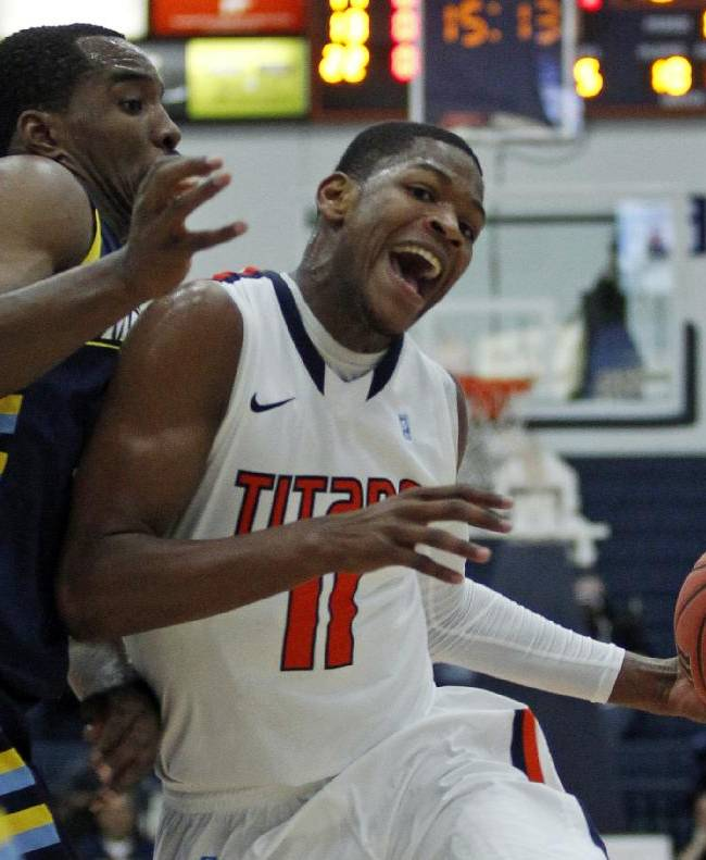 Cal State Fullerton guard Josh Gentry, right, collides into Marquette guard Derrick Wilson, left, defending in the first half of an NCAA college basketball game at the Wooden Legacy tournament Thursday, Nov. 28, 2013, in Fullerton, Calif