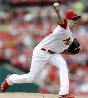 St. Louis Cardinals starting pitcher Joe Kelly throws during the first inning of a baseball game against the New York Mets, Monday, Sept. 3, 2012, in St. Louis. (AP Photo/Jeff Roberson)