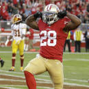 San Francisco 49ers running back Carlos Hyde (28) celebrates after running for a 4-yard touchdown during the fourth quarter of an NFL football game against the Washington Redskins in Santa Clara, Calif., Sunday, Nov. 23, 2014. (AP Photo/Ben Margot)