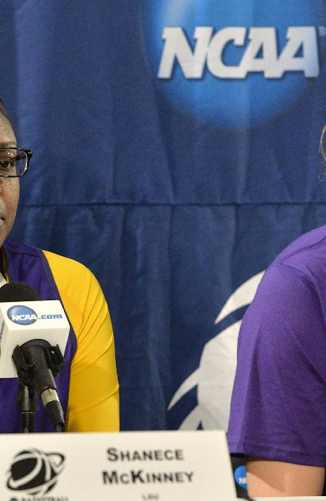 LSU's Shanese McKinney, left, answers a question as teammate Theresa Plaisance looks on during a news conference at the NCAA college basketball tournament in Louisville, Ky., Saturday, March 29, 2014. LSU plays Louisville in a regional semifinal on Sunday