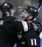 Anaheim Ducks center Saku Koivu, right, celebrates his NHL hockey game-winning goal in overtime with center Andrew Cogliano at an NHL hockey game against the Phoenix Coyotes in Anaheim, Calif., Saturday, Dec. 28, 2013. (AP Photo/Chris Carlson)