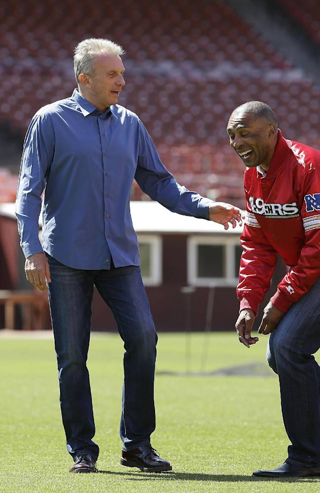 San Francisco 49ers Hall of Fame quarterback Joe Montana, left, and retired running back Roger Craig, right, laugh while walking on the field at Candlestick Park after a news conference about their upcoming flag football game Wednesday, June 4, 2014, in San Francisco.