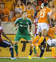 Houston Dynamo midfielder Giles Barnes (23) puts a header past Chivas USA goalkeeper Dan Kennedy (1) for a goal during the first half of an MLS soccer game Saturday, Sept. 21, 2013, in Houston. (AP Photo/Houston Chronicle, Smiley N. Pool)