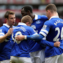 Everton's Gerard Deulofeu, center, celebrates after his shot was turned into the goal by Sunderland's Wes Brown during their English Premier League soccer match at the Stadium of Light, Sunderland, England, Saturday, April 12, 2014