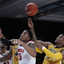 Missouri guard Earnest Ross, right, and Louisville center Zach Price (25) fight for a rebound in the first half of an NCAA college basketball game at the Battle 4 Atlantis tournament on Friday, Nov. 23, 2012, in Paradise Island, Bahamas. (AP Photo/John Bazemore)