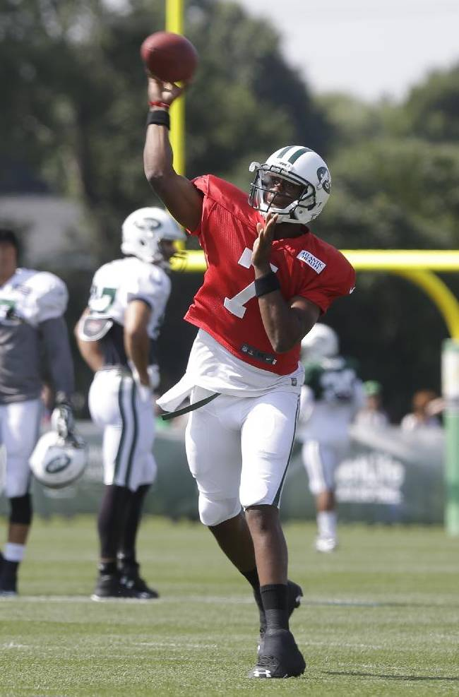 New York Jets' Geno Smith (7) throws a pass at practice during NFL football training camp Saturday, July 26, 2014, in Cortland, N.Y