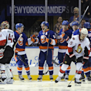 New York Islanders' Kevin Czuczman (24) congratulates Frans Nielsen (51) on his goal, next to teammates Anders Lee, Josh Bailey and Travis Hamonic (3), while Ottawa Senators goalie Craig Anderson (41) and Senators' Erik Karlsson (65) react in the third pe