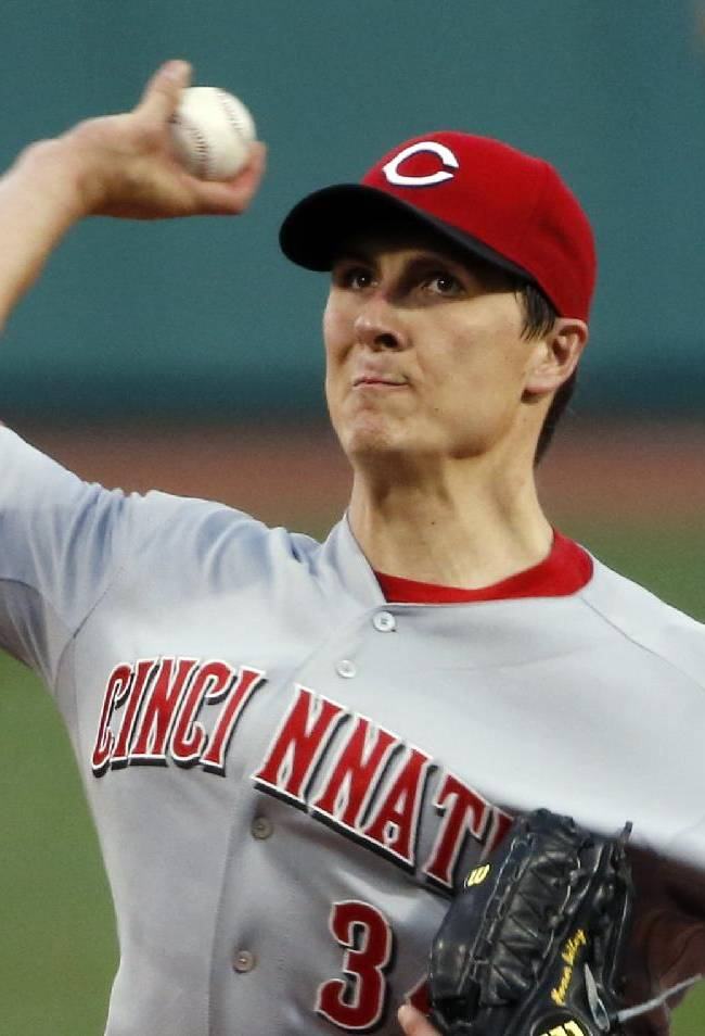 Cincinnati Reds starting pitcher Homer Bailey delivers to the Boston Red Sox during the first inning of a baseball game at Fenway Park in Boston, Tuesday, May 6, 2014