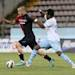 Cagliari's Radja Nainggolan, left, and Lazio's Ogenyi Onazi, fight for the ball during their Serie A soccer match between Cagliari and Lazio, at the Nereo Rocco Stadium in Trieste, Italy, Sunday, May 19, 2013