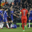 Referee Bjorn Kuipers shows a red card to PSG's Zlatan Ibrahimovic, right, during the Champions League round of 16 second leg soccer match between Chelsea and Paris Saint Germain at Stamford Bridge stadium in London, Wednesday, March 11, 2015. (AP Photo/