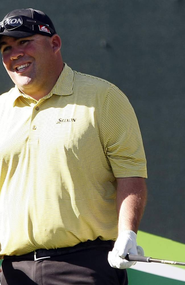 Kevin Stadler reacts to his shot on the 16th hole during the first round of the Waste Management Phoenix Open golf tournament on Thursday, Jan. 30, 2014, in Scottsdale, Ariz