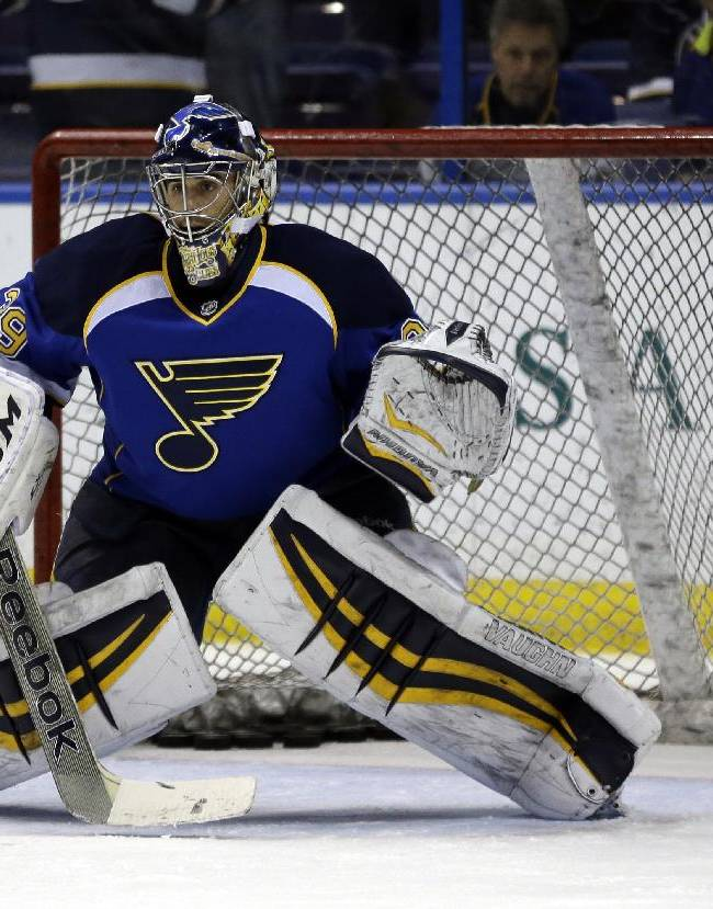 St. Louis Blues goalie Ryan Miller warms up before an NHL hockey game against the Buffalo Sabres, Thursday, April 3, 2014, in St. Louis. Miller is not scheduled to play in the game