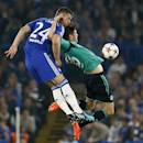 Chelsea's Gary Cahill, left, and Schalke's Klaas Jan Huntelaar challenge for the ball during the Champions League Group G soccer match between Chelsea and Schalke 04 at Stamford Bridge stadium in London Wednesday, Sept. 17, 2014