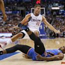 Los Angeles Clippers forward Blake Griffin, rear, is called for a foul on Oklahoma City Thunder forward Serge Ibaka as they fall to the court during the first half of an NBA basketball game in Los Angeles, Wednesday, April 9, 2014 The Associated Press