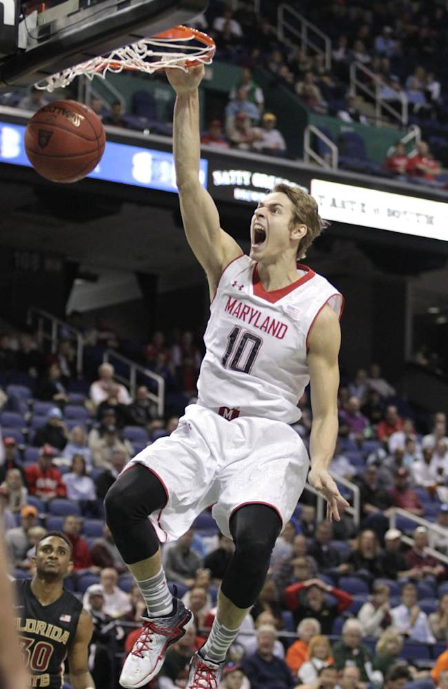 Maryland's Jake Layman (10) dunks against Florida State during the first half of a second round NCAA college basketball game at the Atlantic Coast Conference tournament in Greensboro, N.C., Thursday, March 13, 2014