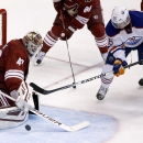 Arizona Coyotes' Devan Dubnyk, left, makes a save on a shot by Edmonton Oilers' Teddy Purcell (16) during the third period of an NHL hockey game Tuesday, Dec. 16, 2014, in Glendale, Ariz. The Coyotes defeated the Oilers 2-1 in overtime The Associated Pres