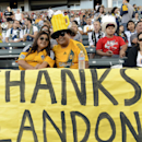 Nefi Chaua, right, and Margie Banuelos, left, pose with a homemade sign for Los Angeles Galaxy's Landon Donovan prior to the game against the Seattle Sounders in an MLS soccer match in Carson, Calif., Sunday, Oct. 19, 2014 The Associated Press