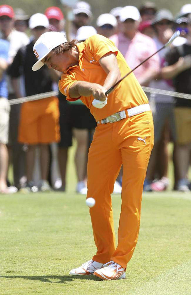Rickie Fowler of the United States plays a shot during the final round of the Australian PGA golf championship held at the Royal Pines Resort, on the Gold Coast, in Australia, Sunday, Nov. 10, 2013