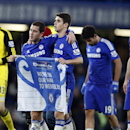 Chelsea's Thibaut Courtois, left, Eden Hazard, 2nd left, Oscar, center, Diego Costa, 2nd right, and goal scorer Branislav Ivanovic celebrate winning the English League Cup semifinal second leg soccer match between Chelsea and Liverpool at Stamford Bridge