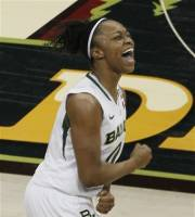Baylor guard Odyssey Sims (0) celebrates during the second half of an NCAA women's Final Four semifinal college basketball game against Stanford, in Denver, Sunday, April 1, 2012. Baylor defeated Stanford 59-47. (AP Photo/David Zalubowski)