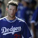 Los Angeles Dodgers starting pitcher Clayton Kershaw walks through the dugout before pitching against the Oakland Athletics in a spring training baseball game Monday, March 3, 2014, in Phoenix The Associated Press